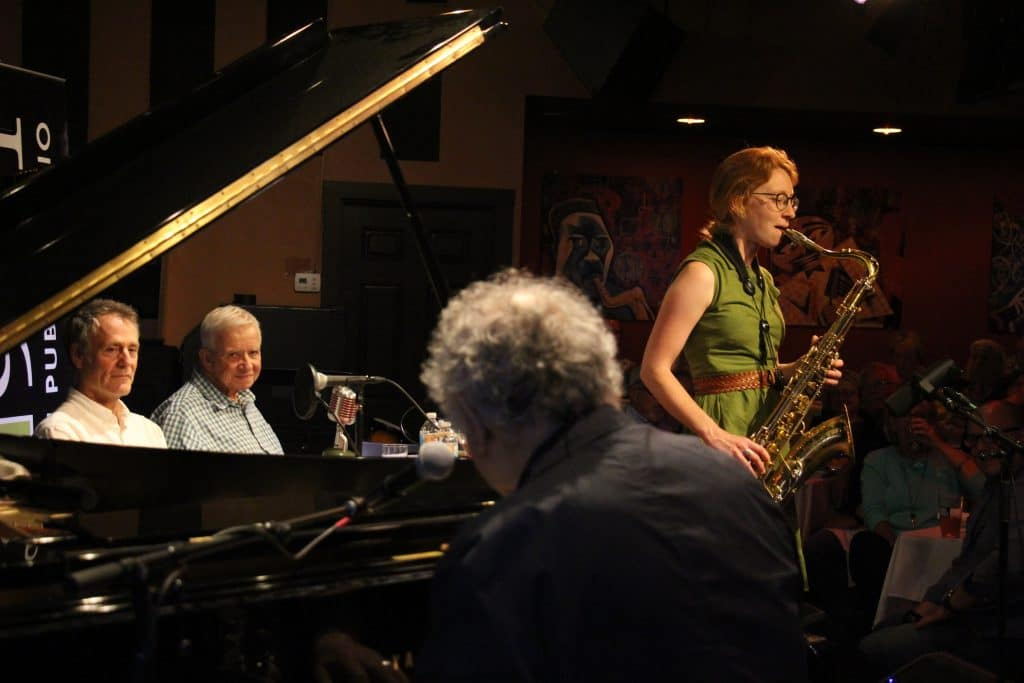 Sophie Faught plays saxophone with David Amram on piano.